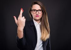 Serious female manager wishing bad luck Royalty Free Stock Photos