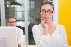 Serious female photo editor in office Royalty Free Stock Photo