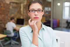 Serious female photo editor in office Stock Photo