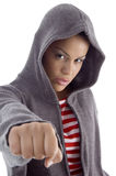 Serious female showing punch Stock Photography
