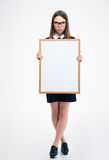 Serious female student holding blank board Stock Photos