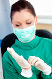 Serious female surgeon wearing scrubs. In her office Stock Images