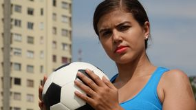 Serious Female Teen Soccer Player. A young female hispanic teen Stock Photos