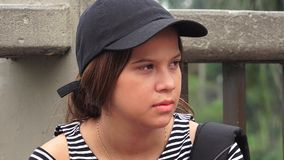 Serious Female Teen Student. Hispanic pretty teen girl student Royalty Free Stock Image