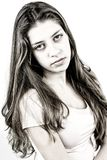 Serious female teenager looking with long wavy hair stock photo