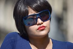 Serious Female Woman Wearing Sunglasses. A pretty young Colombian adult female Stock Images