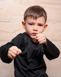 Serious Fighter Kid Posing with Closed Fists Stock Image