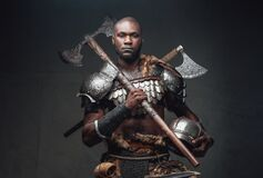 Free Serious Fighter With Black Skin Holding A Helmet And An Axe Royalty Free Stock Image - 215536836