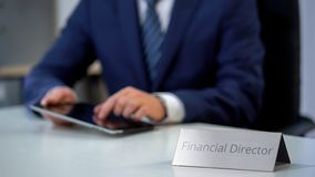 Serious financial director of corporation working on tablet pc, budget planning. Stock photo stock photography