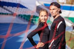 Serious fit couple resting after training. In the arena . copy space. sporty youth concept stock photos