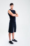 Serious fitness man standing with arms folded Stock Photography