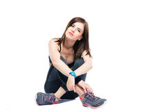 Serious fitness woman resting on the floor Stock Images