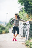 Serious fitness young woman outdoors Royalty Free Stock Image