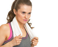 Serious fitness young woman with towel looking on copy space Stock Photo