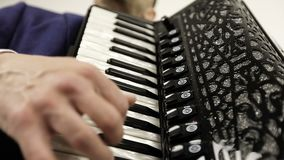 Serious, focused musician in a fashionable suit enjoys playing the accordion. stock video footage