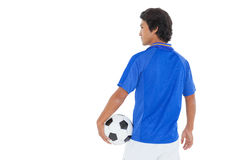 Serious football player over white background Stock Photography
