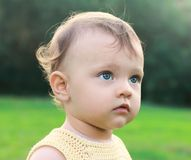 Serious fun baby girl on nature stock photography