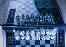 Serious game. Chess - a game for two people that is played on a board with 64 black and white squares called a chessboard Royalty Free Stock Photography