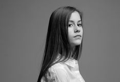 Serious gaze. Portrait of beautiful young teen with serious expression Royalty Free Stock Image