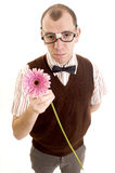 Serious Geeky Guy with Flower. This image shows a nerd like guy offering a flower Stock Image