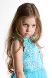Serious girl. Studio portrait of serious nine years old girl isolated on white royalty free stock image