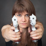 Serious girl aims from two pistols close up Royalty Free Stock Photo