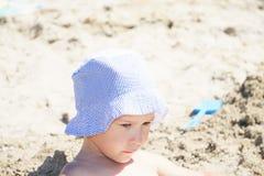Serious girl on beach Stock Photos