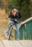 Serious girl biker. Stock Photos