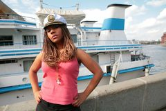 Serious girl in captain cap Royalty Free Stock Image