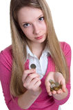 Serious girl with coins on hands Stock Photo