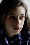 Serious girl in the dark thinking Stock Photography