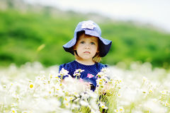 Serious girl in field Royalty Free Stock Image