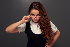 Serious girl in formal wear and glasses Royalty Free Stock Image