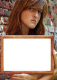 Serious girl with frame Royalty Free Stock Photos