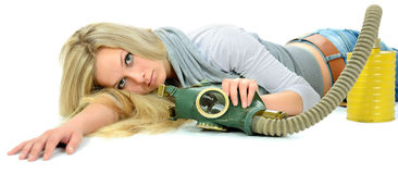 The serious girl with gas mask. Stock Photography