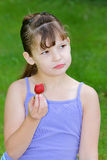 Serious Girl Holding Strawberry Stock Image