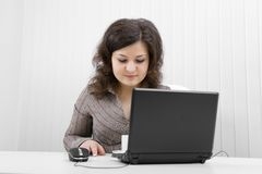 The serious girl with the laptop Royalty Free Stock Photos