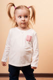 Serious Girl. Little girl looking serious with a distant gaze, vertical  studio portrait Stock Images