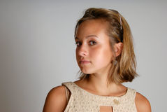 Serious Girl Looking at Camera. A pretty girl looking at the camera, gray background Stock Photography