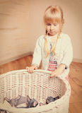 Serious Girl Looking at Sphynx Kittens in a Basket Stock Images