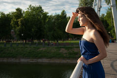 Serious girl looks into the distance near river Stock Photography