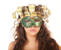 The serious girl in a mask Stock Photography