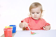 Serious girl painting with brush Royalty Free Stock Photo