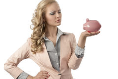 Serious girl with piggybank Stock Photo