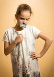 Serious girl playing with decorative mustaches Royalty Free Stock Photography