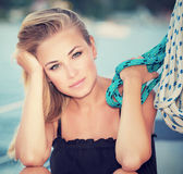 Serious girl on sail boat Royalty Free Stock Image