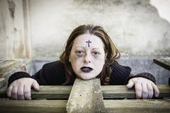 Serious girl satanic. Girl with satanic and gothic cross, halloween Royalty Free Stock Photo