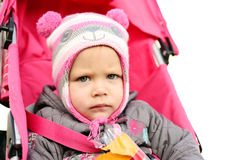 Serious girl in stroller Stock Images