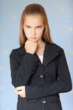 Serious girl-teenager in business Royalty Free Stock Photography