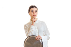 Serious girl waitress in uniform with trey in hands Stock Photos